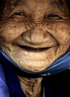 Title : LOVELY SMILE Description : This is a portrait of a old woman in the province of Phu Yen, Vietnam. Photographer Name : Dzung Viet Le