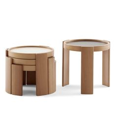 """Frattini Nesting Tables 780/783 Gianfranco Frattini Cassina, Italy 1966 The Frattini Nesting Tables 780/783 are a clever, practical design that has now been in continuous production through Cassina for nearly 50 years. Frattini conceived his Nesting Tables 780/783 as drum-like forms that precisely overlap each other so that all tables could efficiently """"nest"""" within a small footprint – when stacked, the gently curved legs of each table form a visually engaging pattern of cascading vertical…"""