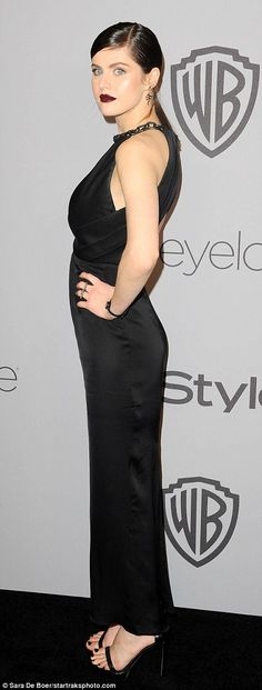 Chest a glimpse: Baywatch star Alexandra Daddario wowed in a halterneck dress with cut-out...
