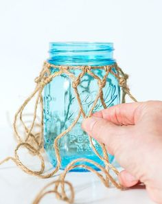 Recommended Tips:How to Make Fishnet Wrapped Mason Jar - Recommended Tips How to Make Fishnet Wrapped Mason Jar - Looking for a unique idea for decorating a mason jar? This Fishnet Wrapped Mason Jar has an ocean look with the Pot Mason, Blue Mason Jars, Mason Jar Lids, Bottles And Jars, Mason Jar Crafts, Twine Crafts, Diy And Crafts, Wine Bottle Crafts, Bottle Art