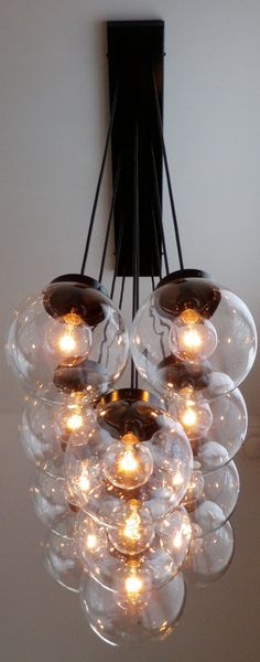 Stasis Globe Chandelier: 11 Large Hanging Clear Glass Globes. $795.00, via Etsy.