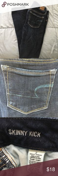 "American Eagle Skinny Kick Jeans Size 2 Excellent condition. American Eagle dark wash skinny kick jeans in size 2. These jeans have a slight flare similar to a bootcut. Great for school or a night out. They have a great stretch to them which makes it very comfy!  ***FAST SHIPPING   ***10% OFF 2+ ITEMS-- CLICK ""ADD TO BUNDLE""   Want to Bundle? Here are some options! - H&M Navy Cardigan Size S $10 - Abercrombie & Fitch Floral Shirt Size M $12 - Black Cardigan with Pockets Size S $12 - Peach J…"