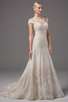 Romantic wedding dress idea - This regal A-line features scalloped patterns  of embellished lace · Wedding GownsPretty Wedding DressesPerfect ... da2d44885bbe