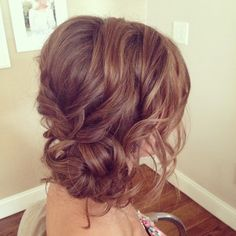 Love how the bun is off to the side and the size of the curls ...