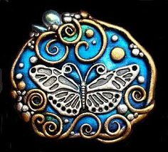 Christina A Kapono, polymer clay, pearl ex powders, crystals, metal butterfly charm