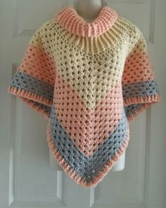 Hot Off My Hook! Project: Cowl Neck Poncho Started: 06 Apr 2016 Completed: 09 Apr 2016 Model: Madge the Mannequin Crochet Hook(s): K Cowl Portion, K, Granny Stitch portion Yarn: I Love This Yarn Color(s): Light Peach, Crean, Grey Mist Pattern Source: Simply Crochet Magazine, Issue No. 25 (Hard Copy) Pattern Designed By: Simone Francis Notes: This is my 82cd Cowl-Neck Poncho!