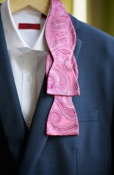 Pink paisley tie on a charcoal suit and sharp white shirt via Every Last Detail- Lover.ly