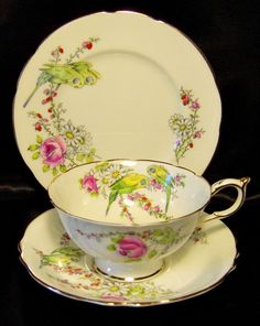 A gorgeous Paragon trio produced to commemorate the birth of Princess Margaret Rose, sister to Queen Elizabeth II, on August 21, 1930. Princess Margaret Rose passed away on February 9, 2002, at the age of 71. This trio is the round bone white with gold trim, consisting of a beautiful low, wide tea cup, saucer and side plate.