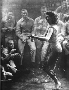 Rita Hayworth dancing for WWII soldiers in a smoky bar