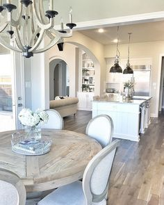 Love the chandelier and wonderful table! Perfect!!! Fixer Upper style kitchen and dining room area
