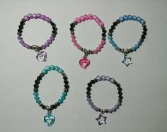 Check out this item in my Etsy shop https://www.etsy.com/listing/216998657/girls-charm-name-bracelets-with-clear