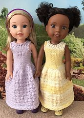 """This dress starts at the bottom with the skirt pattern and works up to the neckline. It's an easy pattern to knit and fits the new American Girl WellieWishers 14"""" dolls."""
