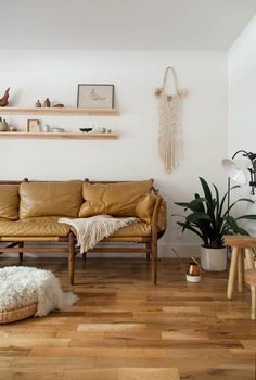 I am pretty obsessed with the camel leather sofa trend going on right now.  This rich, buttery hue paired with a sleek silhouette brings such warmth  and texture to a space, and I'm all about that warmth and texture.  Although it is a neutral, camel's muted burnt orange shade can still be a  l