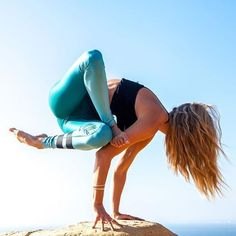 yoga arm balance / blue green leggings
