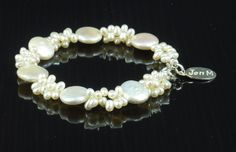 Fabulous bracelet in freshwater Pearl, sweet little top drilled 3-5mm pearl bunches with 12mm flat Biwa Coin pearls, withy 925 sterling silver, sterling JMD logo tag, made to order, made to measure, made for YOU!