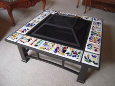 Fire pit - Fire pit was purchased at Target.  Took out the granite border and replaced with the kids' mosaic tiles.