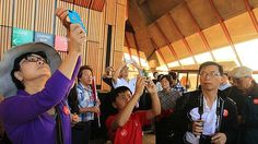 Chinese tourists on a Mandarin Tour of the Sydney Opera House, Sydney. 27th December 2012. Great article for Hospitality