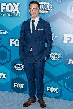 WHAT: Tommy Hilfiger suit, To Boot New York shoes WHERE: Attending the 2016 Fox Upfront presentation in New York City WHEN: May 16, 2016 WHY: Samberg shows you how to up your suited man game without losing any of the office appropriate-ness. The key here is his perfectly fitted windowpane suit that's bolder than basic navy, but hardly Jaden-level in its swerviness.