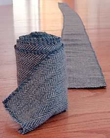 During the Viking age, the fabric would have been woven to the correct dimensions for the intended purpose, rather than cut from larger piece of cloth, as was done for the replica shown to the right. As a result, a leg wrap from the Viking age would have selvages along each edge which resisted fraying, rather than a stitch used on the modern replica.