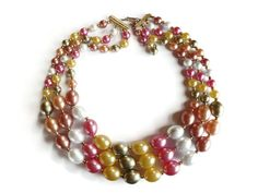 A pretty 1960s multi strand plastic beaded necklace. The colors are beautiful for the spring and summer and will even brighten your day in the