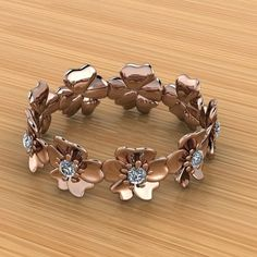 You won't see this beautiful rose gold and diamond hibiscus band on anyone else's finger.  #custom #CarrollsDesignStudio #rosegold #ring #hibiscus