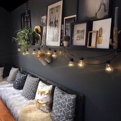 Love the string lights under the shelf!