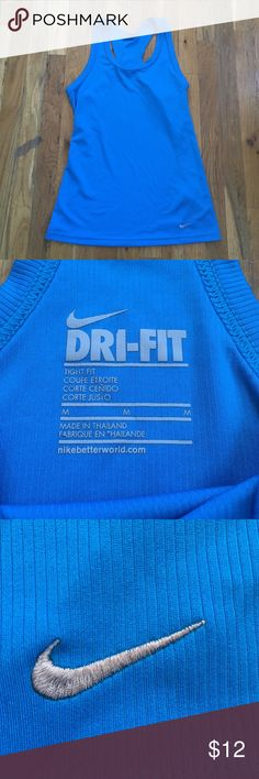 Nike Dri fit tank top Nike Dri fit tank in a really pretty blue color. Ribbed fabric, fits close to the body. 100% polyester. Pre loved but in excellent condition. Nike Tops Tank Tops