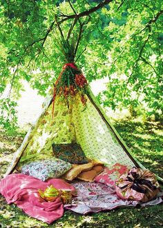 Bohemian tents with patterns, colors, and comfy pillows.