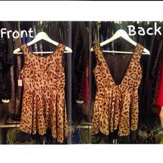 Deep V-back #leopard print mini #dress. E-mail shop@AuthorityGirl.com