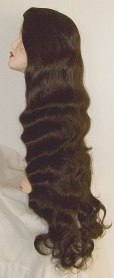 A very, very long wig made of synthetic hair is a wavy style.