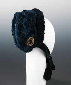 Bonnet. Made in Paris in October 1882, the contrast of the two-toned velvet as well the textures of the plush gives this fairly simple bonnet a luxurious and interesting appearance, and is exemplary of the 1880s vogue for richly textured upholstery-like textiles. Silk