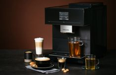 Na IFA 2018 se dočkali i milovníci skvělé kávy. Nový volně stojící kávovar CM 7750 CoffeeSelect, který nabízí čtyři užitečné funkce, dostupné pouze u Miele. Pouhým stiskem tlačítka můžete zvolit jeden ze tří různých druhů kávy, a jistě oceníte i tichý chod kuželového mlýnku znerezové oceli, který mele jemně a beze zbytků, nebo automatické odvápňování a senzorové čidlo, jež nastavuje výšku trysky nad šálkem. Kávový labužník si navíc může vybrat ze 16 kávových specialit, jako je káva… Info Board, Kegel, Popcorn Maker, Espresso Machine, Coffee Maker, Kitchen Appliances, Coffee Mornings, Cup Of Coffee, Vending Machines