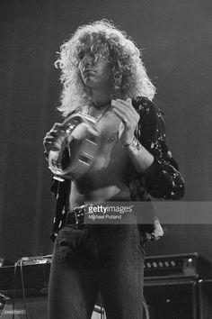 Singer Robert Plant performing with British heavy rock group Led Zeppelin, at Earl's Court, London, May 1975. The band were initially booked to play three nights at the venue, from 23rd to 25th May, but due to public demand, two more concerts were later added, for 17th and 18th May. Total ticket sales were 85,000.