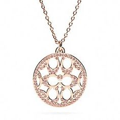 COACH Pave Signature Disc Necklace in Rosegold. Really Pretty