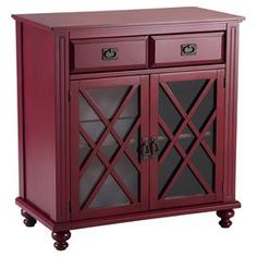 """This versatile cabinet table brings sommelier-worthy style to your dining room with its antiqued red finish and interior bottle rack. Stocked with towels and toiletries, it doubles as a valet in your guest bath.   Product: Wine cabinetConstruction Material: Rubberwood, engineered wood, metal and glassColor: Antique redFeatures:  Two latticed doorsTurned feetTwo drawers Interior bottle rack One interior shelf  Dimensions: 36"""" H x 34"""" W x 18.12"""" DAssembly: Assembly required"""