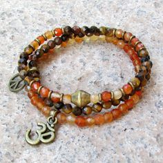 Cool little bracelets, in beautiful colors and intricate style, bright faceted carnelian gemstones paired with earthy tiger's eye and hand made brass African trade beads, make for an awesome boho chic