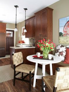 I can't say enough good stuff about this space but I must draw your attention to one more amazing thing about the design. The banquette is constructed using WALL cabinets! Extra seating and storage!  The folks at BHG are brilliant!