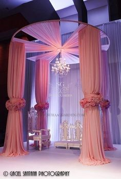 Tall, circular Mandap with floral cuffs. A simply stunning fabric mandap! Floral cuffs and dropped chandelier for the WOW factor! Wedding Stage Decorations, Wedding Themes, Wedding Designs, Wedding Events, Wedding Ceremony, Wedding Columns, Decor Wedding, Hall Decorations, Indoor Ceremony