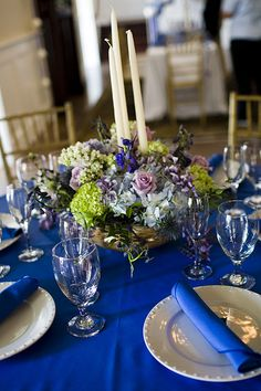 Sapphire blue wedding table settings. Every table was different by Island Gardener, via Flickr