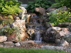 A waterfall is one of the most beautiful and sought-after landscape water features. If space is limited in your yard, consider adding a Pondless Waterfall. Waterfall Landscaping, Pond Waterfall, Pond Landscaping, Small Waterfall, Landscaping Software, Backyard Water Feature, Ponds Backyard, Backyard Waterfalls, Backyard Ideas