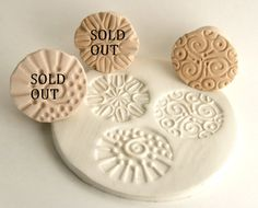 These three round texture stamps each feature a different pattern. They are a little bigger than my usual texture stamps. This listing is for one (1) stamp in bisque. Options 1 and 2 have sold but Option 3 is still available. Here are my other texture stamps: https://www.etsy.com/shop/GiselleNo5?section_id=13390448 And other stamps for working with small items: https://www.etsy.com/shop/GiselleNo5?section_id=13267061 IMPORTANT: By purchasing this listing you agree to all shop policies, ...