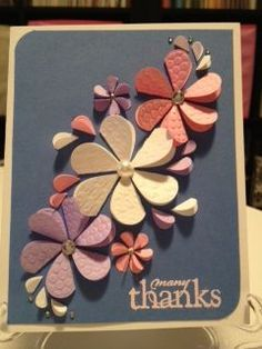 """Another folded heart floral card. The colors are a bit different, but I like it. I like how there are a few petals """"spiraled"""" off the larger flowers, adds a bit of whimsy."""