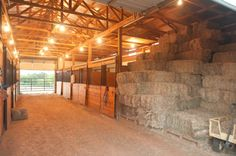 Although I don't like keeping hay in the same barn as the horses stalls, this isn't a bad set up...