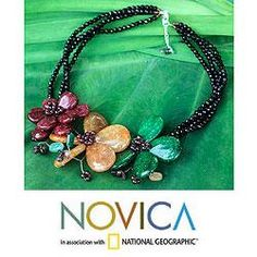 @Overstock - Nareerat handcrafts this torsade necklace with three strands of black glass beads. The necklace is centered by yellow, green and burgundy-pink dyed quartz flowers accentuated by garnets and chip-cut tourmalines.http://www.overstock.com/Worldstock-Fair-Trade/Handcrafted-Multi-gemstone-Sparkling-Bouquet-Necklace-Thailand/6549624/product.html?CID=214117 $55.79