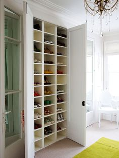 These custom-made cubbies are perfect for storing shoes in a dressing room or bedroom. White shelves reflect light, making it easier to see the contents of each space. (Photo: Antony Crolla)