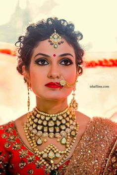 Indian Wedding Jewelry - Bride in a Red and Gold Lehenga with Polki Jewelry | WedMeGood #wedmegood #indianbride #indianwedding #polki #weddingjewelry #polkijewlery #bridalportrait