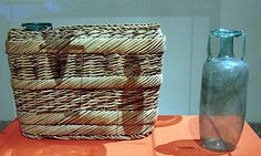 Basket, divided to hold three bottles            Period: Roman Period  Date: A.D. 2nd–3rd century  Geography: Middle Egypt, Maghagha  Dimensions: H. 21 x W. 30 x D. 11.5 cm (8 1/4 x 11 13/16 x 4 1/2 in.)
