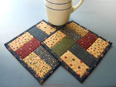 Quilted Pot Holders /Set of two with Patchwork of fabric in burgundy…