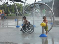 Children love the splash pad at Taylor\'s Dream: Inclusive Playground in Fort Wayne.