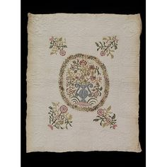 Cot quilt, VA, decorated with floral embroidery and quilted date of 1703.